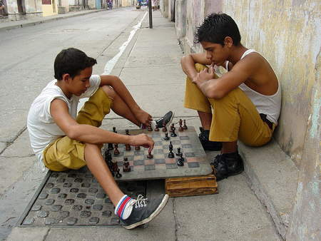 Boys playing a game of chess in Santiago de Cuba, Cuba