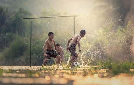 Children playing soccer (football)