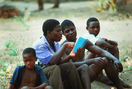 Boys reading together in Malawi, East Africa