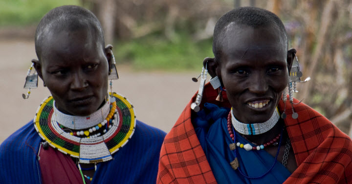 Maasai women in traditional clothing and jewelry in the Serengeti National Park, Tanzania. Photo credit: William Warby, www.flickr.com/photos/wwarby