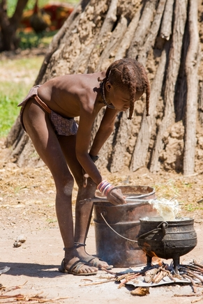 A Himba Boy Cooks Lunch