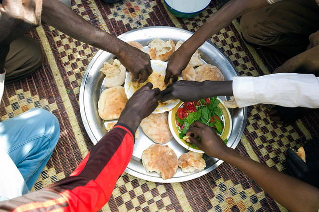 Food sharing in Turba Village, North Darfur. Credit: Photo by Albert Gonzalez Farran - UNAMID