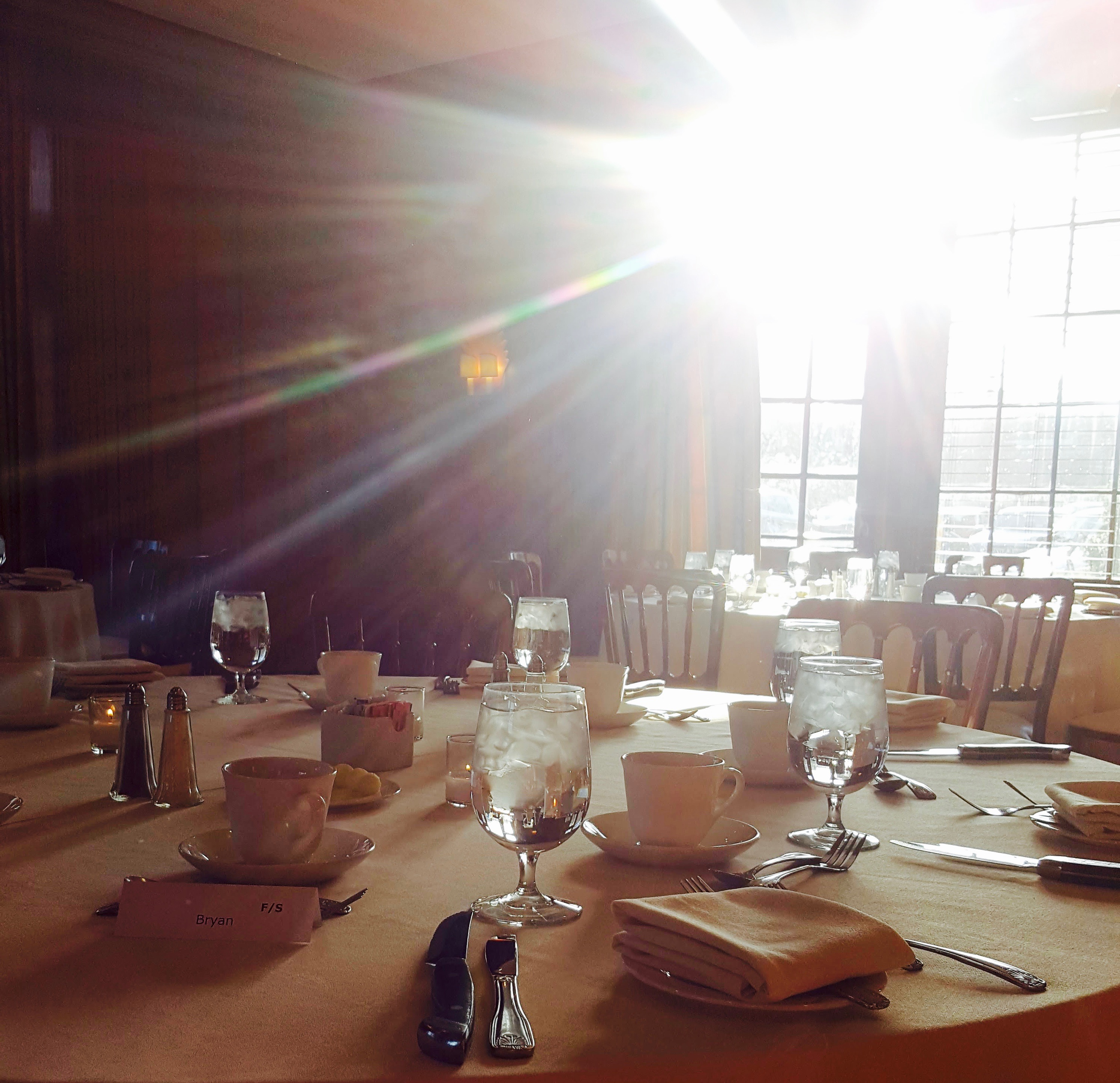 Light streaming in from window while board members mingle for drinks at the New Haven Lawn Club banquet.
