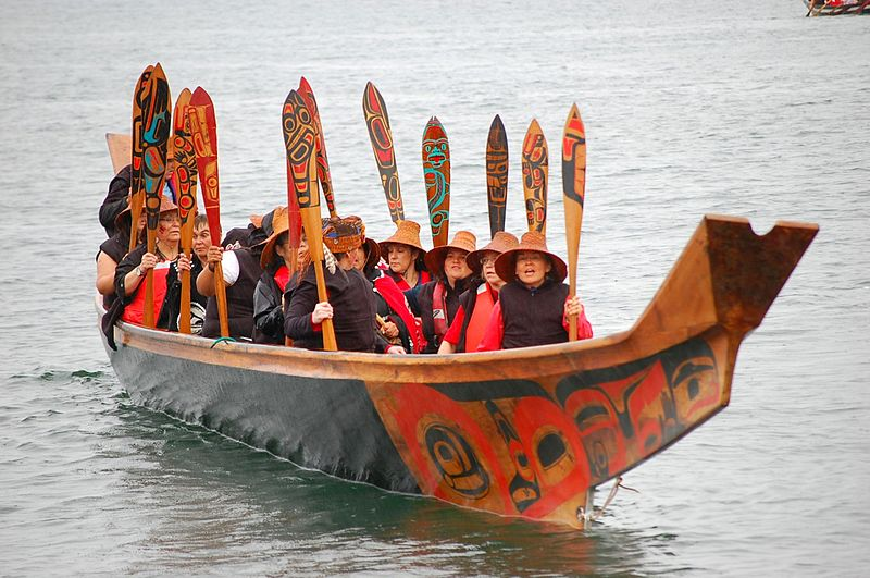 Haida sailors traveling in a canoe