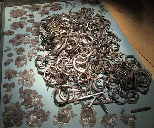 Pile of silver artifacts.