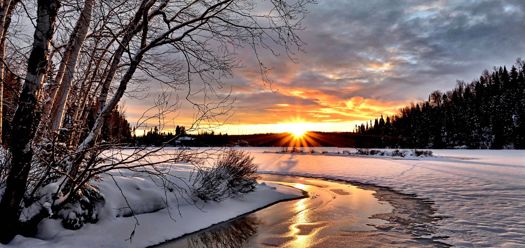 snow, sun, and frozen river