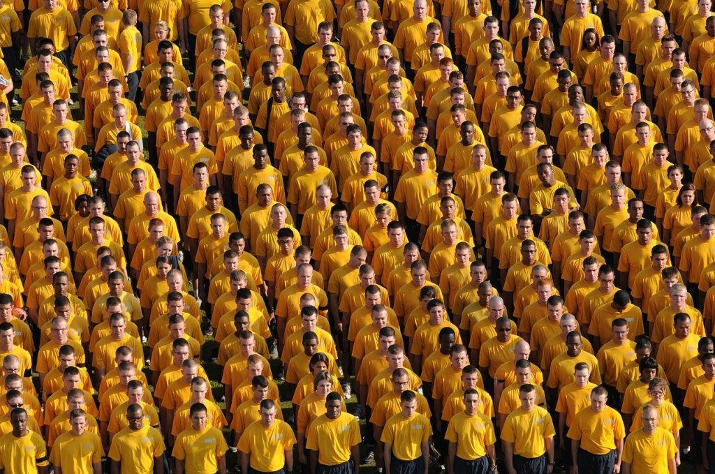 rows of people in yellow shirts
